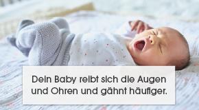Dein Baby reibt sich die Augen und Ohren und gähnt häufiger.