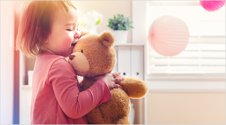 Kind mit Teddybären