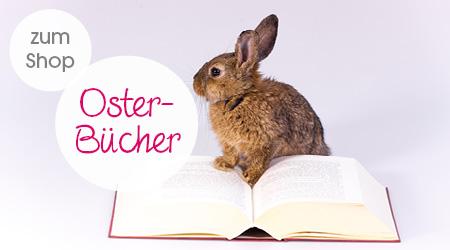 Ein Hase sitz auf einem Buch