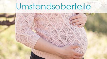 Schwangere in rosa Umstandspullover