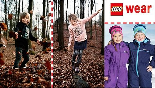 Kinder in Outdoorkleidung spielen im Wald